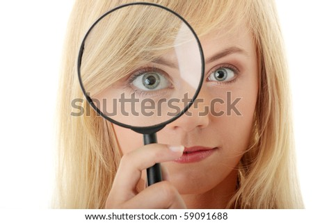 Teen girl with magnifier, isolated on white