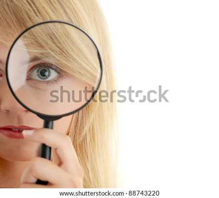 Teen girl with magnifier, isolated on white - stock photo