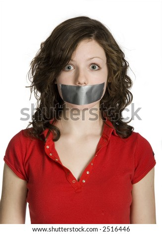 teen girl with mouth taped closed - stock photo