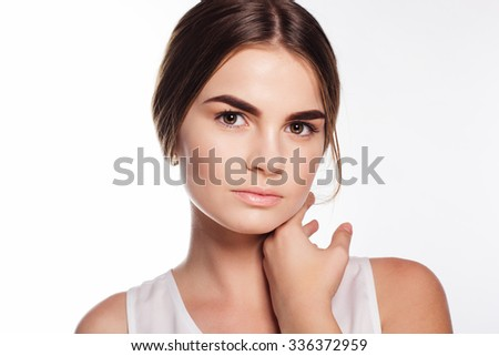 Teen girl with perfect skin and nude makeup on her face - stock photo