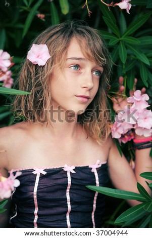 Teen girl with pink flower in her hair