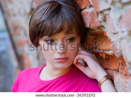 teen girl with sad expression - stock photo