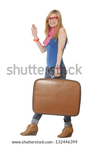 Teen girl with suitcase at white background - stock photo