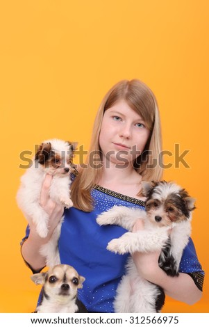 teen girl with the cute little puppies