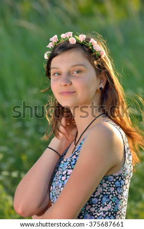 teen girl with wreath in summer time - stock photo