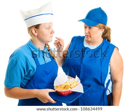 Teen girl working in fast food gets pushed around by her boss.  Isolated on white. - stock photo