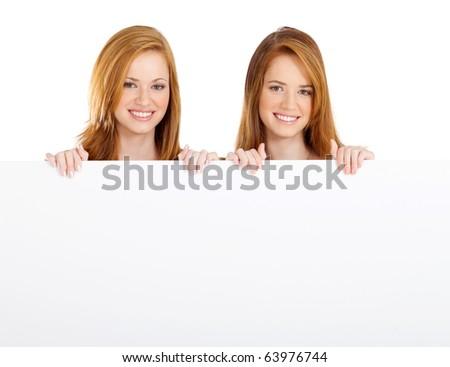 teen girls holding white board - stock photo