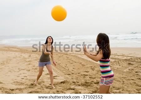 teen girls playing beach ball - stock photo