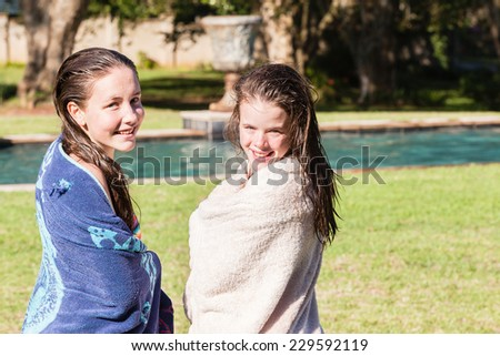 Teen Girls Swim Towels Teenagers girls swim towels drying hangout summers day home talk laugh playtime - stock photo