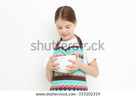 Teen holding white bowls - stock photo