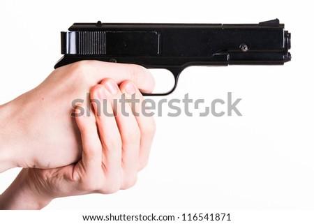 Teen holds a handgun on white background - stock photo