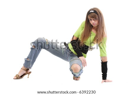 Teen in casual clothing - ripped jeans, headband, wrist bands - stock photo