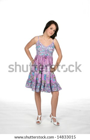 teen in purple dress with hand on her hip - stock photo