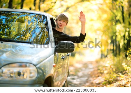 Teen is trained to ride a car - stock photo