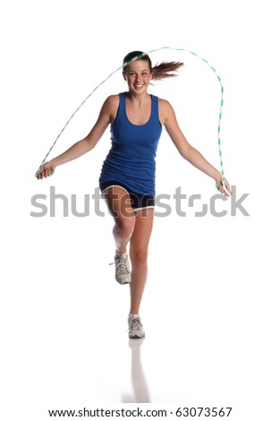 Teen jumping rope on white background