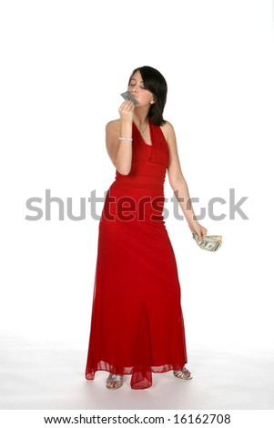 teen kissing credit card and holding cash - stock photo