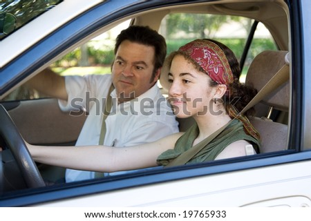 Teen learning to drive or taking driving test. - stock photo
