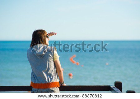 Teen looking out towards the horizon, a future concept - stock photo