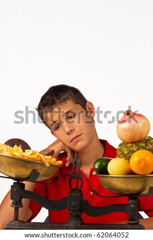 Teen  missing his junk food after a fruit diet - stock photo