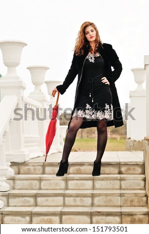 teen model girl with umbrella  - stock photo