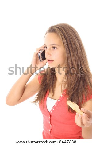teen on cellphone eating a cookie