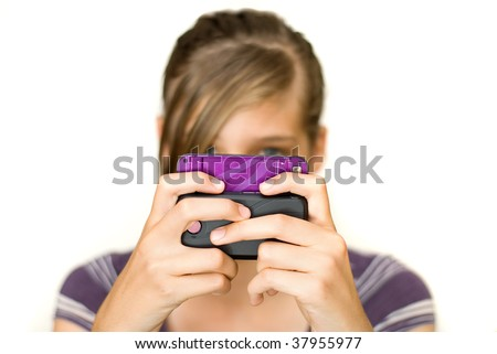Teen or pre teen girl texting on her cell phone