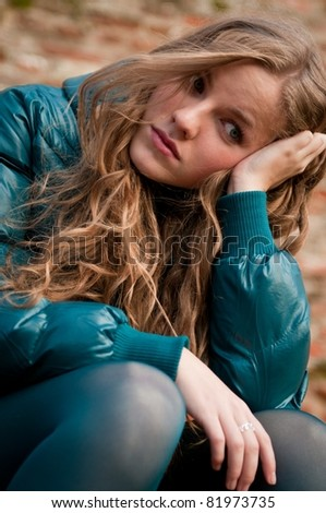 Teen person depressed outdoors - stock photo