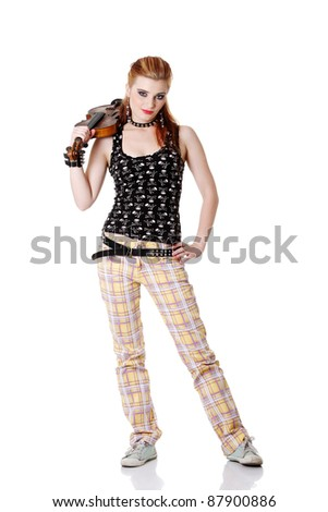 Teen pretty punk girl standing and holding fiddle on her arm. Isolated on white. - stock photo