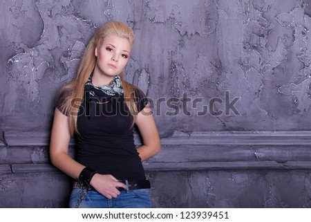 teen punk girl against wall background - stock photo