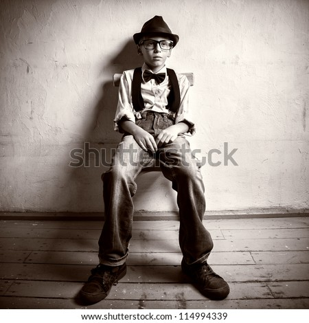 Teen sits on a chair - stock photo