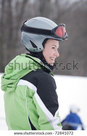 Teen Skier against background of snow and woods. - stock photo