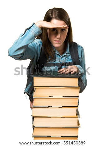 Teen student girl with a lot of books and showing something