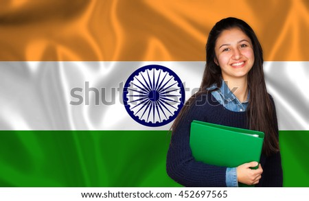Teen student smiling over Indian flag. Concept of lessons and learning of foreign languages.