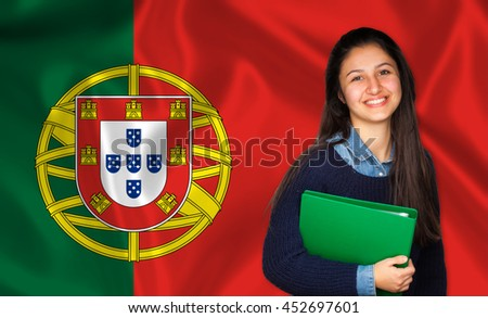 Teen student smiling over Portuguese flag. Concept of lessons and learning of foreign languages.