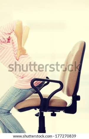 Teen student woman with back pain - stock photo