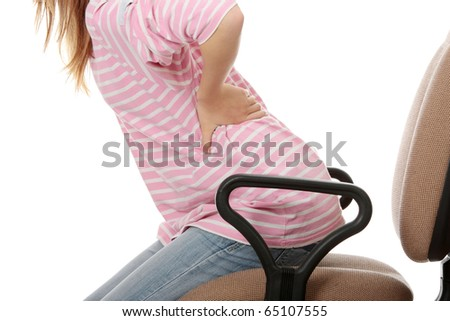 Teen student woman with back pain isolated - stock photo