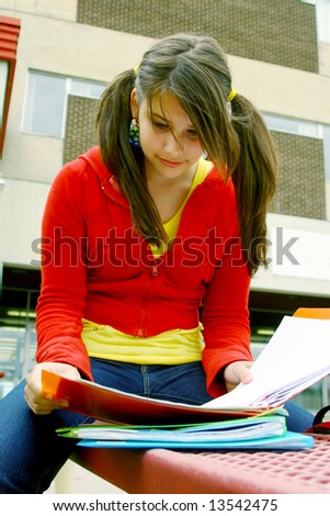 Teen studying on a bench
