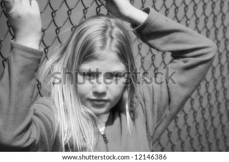 Teen who is feeling trapped and upset - stock photo