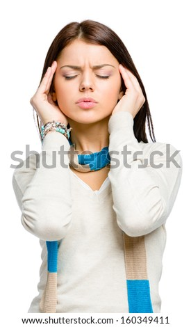 Teen with eyes closed puts hands on head because of headache or unsolvable problems, isolated on white
