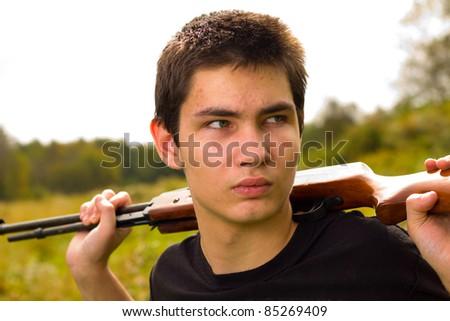 teen with gun - stock photo
