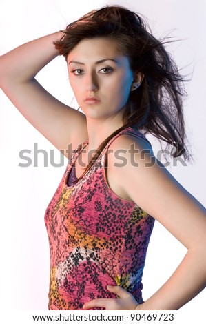 Teen woman listening to music on white with long dark hair and tank top - stock photo