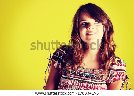 Teen woman portrait against green wall - stock photo