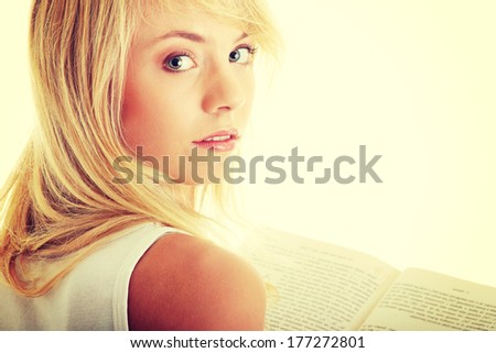 Teen woman reading book , isolated on white background