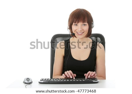 Teen woman using pc, with headphones on her head - e learnig concept - stock photo