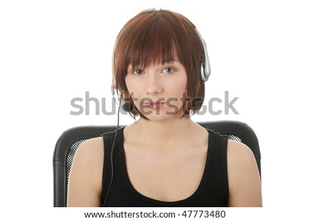 Teen woman using pc, with headphones on her head - elearnig concept - stock photo