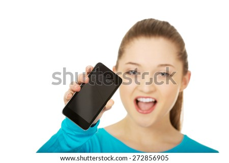 Teen woman with a broken cracked phone screen.