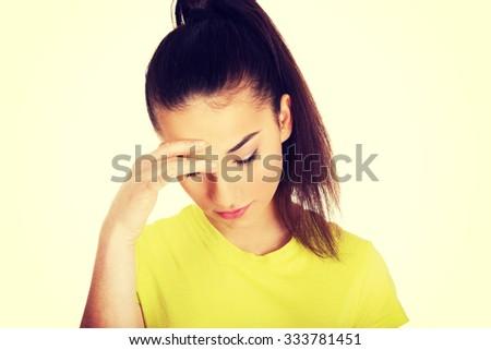 Teen woman with a headache holding head. - stock photo