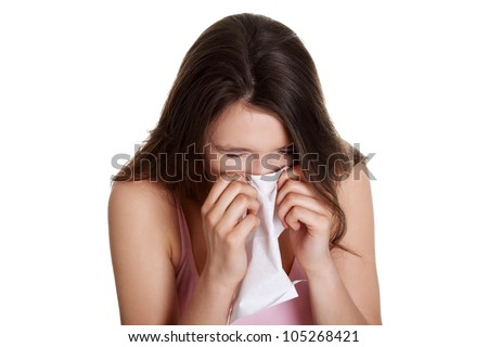Teen woman with allergy or cold, isolated on white background - stock photo