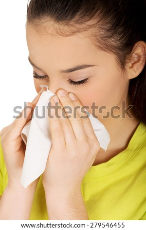 Teen woman with allergy or cold sneezing to tissue. - stock photo