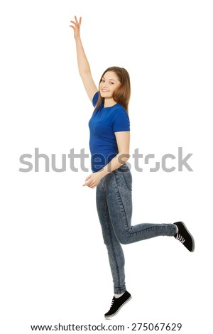 Teen woman with hand up holding copy space. - stock photo